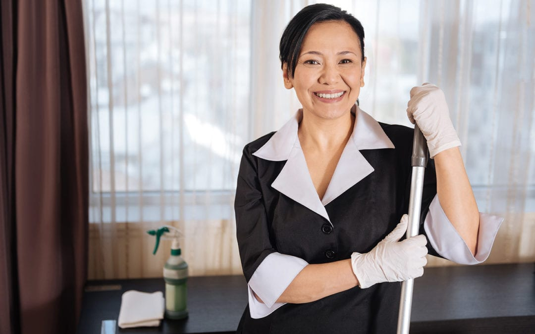 a member of the janitorial staff smiling